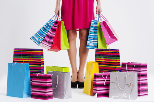 Woman with too many shopping bags
